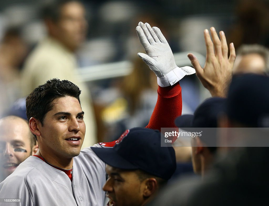 Jacoby Ellsbury #2 of the Boston Red Sox is congratulated in the dugout after scoring in the first inning against the New York Yankees on October 3, 2012 at Yankee Stadium in the Bronx borough of New York City.