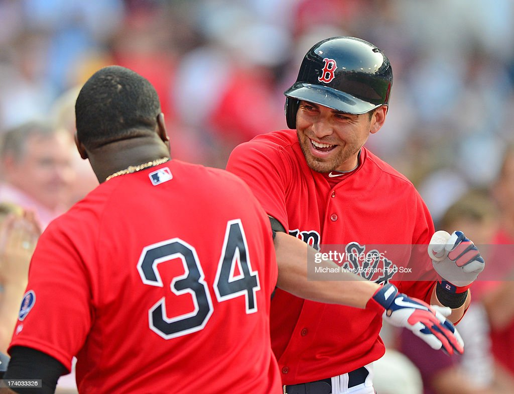 Jacoby Ellsbury #2 of the Boston Red Sox is greeted by teammate David Ortiz #34 after hitting a home run against the New York Yankees in the first inning on July 19, 2013 at Fenway Park in Boston, Massachusetts.