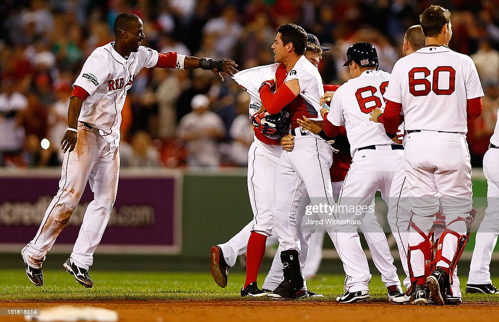 Jacoby Ellsbury #2 of the Boston Red Sox is mobbed by his teammates including Pedro Ciriaco #77 following his walk-off RBI in the bottom of the ninth inning against the New York Yankees during the game on September 11, 2012 at Fenway Park in Boston, Massachusetts.