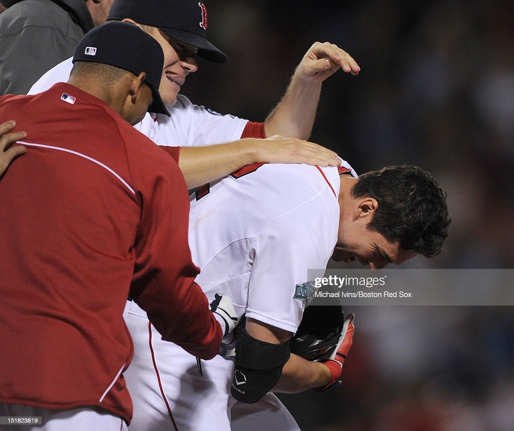 Jacoby Ellsbury #2 of the Boston Red Sox is mobbed by teammates after hitting a game-winning single against the New York Yankees in the ninth inning on September 11, 2012 at Fenway Park in Boston, Massachusetts.