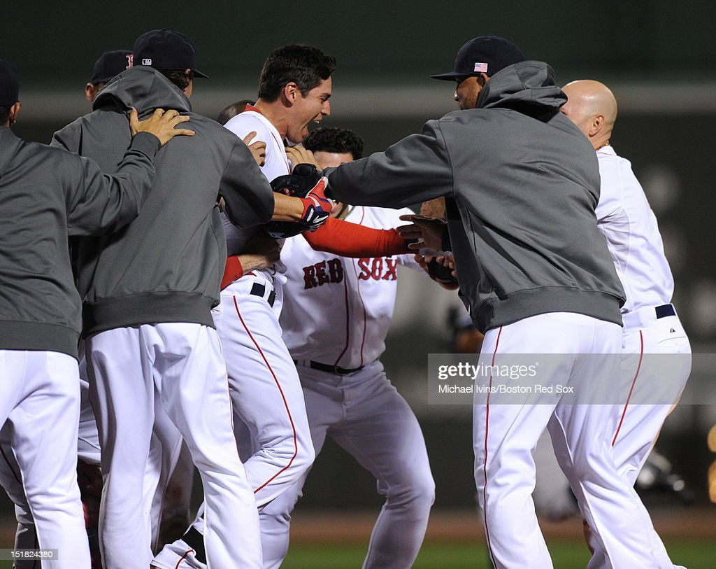 <a gi-track='captionPersonalityLinkClicked' href=/galleries/search?phrase=Jacoby+Ellsbury&family=editorial&specificpeople=4172583 ng-click='$event.stopPropagation()'>Jacoby Ellsbury</a> #2 of the Boston Red Sox is mobbed by teammates after hitting a game-winning single against the New York Yankees in the ninth inning on September 11, 2012 at Fenway Park in Boston, Massachusetts.