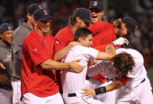 Jacoby Ellsbury of the Boston Red Sox knocks in the winning run and celebrates against the Cleveland Indians at Fenway Park on August 2 2011 in...