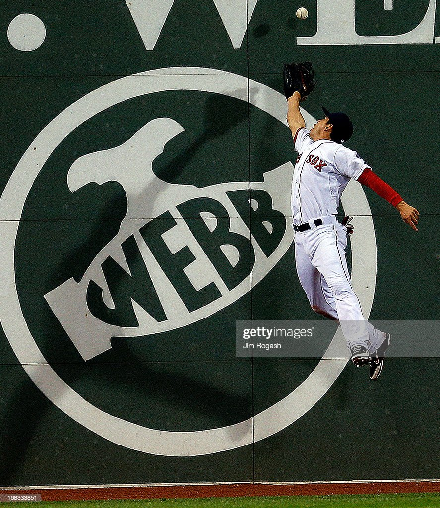 <a gi-track='captionPersonalityLinkClicked' href=/galleries/search?phrase=Jacoby+Ellsbury&family=editorial&specificpeople=4172583 ng-click='$event.stopPropagation()'>Jacoby Ellsbury</a> #2 of the Boston Red Sox leaps for a ball off the wall hit by Ryan Doumit #9 of the Minnesota Twins in the 7th inning at Fenway Park on May 8, 2013 in Boston, Massachusetts.