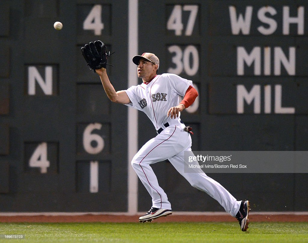 <a gi-track='captionPersonalityLinkClicked' href=/galleries/search?phrase=Jacoby+Ellsbury&family=editorial&specificpeople=4172583 ng-click='$event.stopPropagation()'>Jacoby Ellsbury</a> #2 of the Boston Red Sox makes a catch against the Philadelphia Phillies in the seventh inning on May 27, 2013 at Fenway Park in Boston, Massachusetts.