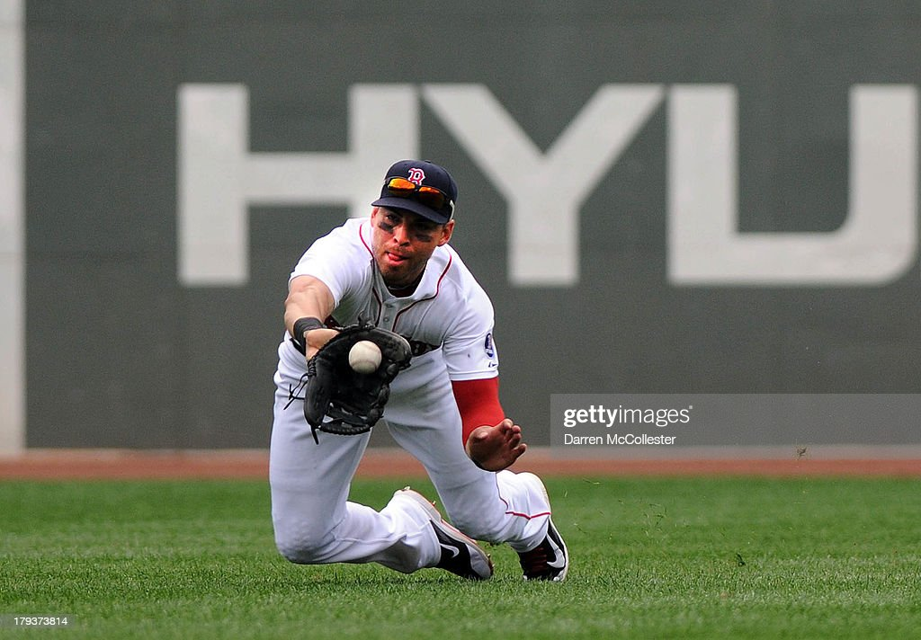 <a gi-track='captionPersonalityLinkClicked' href=/galleries/search?phrase=Jacoby+Ellsbury&family=editorial&specificpeople=4172583 ng-click='$event.stopPropagation()'>Jacoby Ellsbury</a> #2 of the Boston Red Sox makes a diving catch in the fourth inning against the Detroit Tigers at Fenway Park on September 2, 2013 in Boston, Massachusetts.