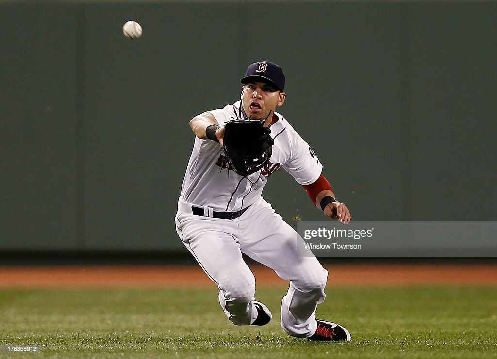 <a gi-track='captionPersonalityLinkClicked' href=/galleries/search?phrase=Jacoby+Ellsbury&family=editorial&specificpeople=4172583 ng-click='$event.stopPropagation()'>Jacoby Ellsbury</a> #2 of the Boston Red Sox makes a lunging catch on Brian Roberts #1 of the Baltimore Orioles during the seventh inning of the game at Fenway Park on August 29, 2013 in Boston, Massachusetts.