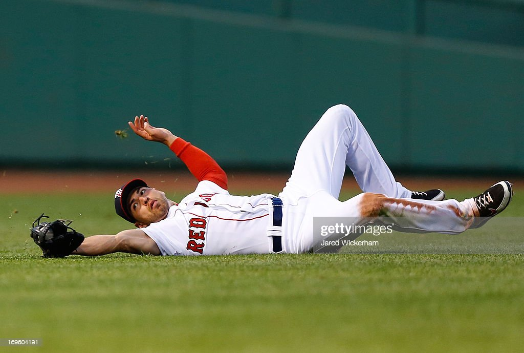 <a gi-track='captionPersonalityLinkClicked' href=/galleries/search?phrase=Jacoby+Ellsbury&family=editorial&specificpeople=4172583 ng-click='$event.stopPropagation()'>Jacoby Ellsbury</a> #2 of the Boston Red Sox makes a sliding catch in center field against the Philadelphia Phillies during the interleague game on May 28, 2013 at Fenway Park in Boston, Massachusetts.