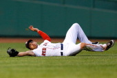 Jacoby Ellsbury of the Boston Red Sox makes a sliding catch in center field against the Philadelphia Phillies during the interleague game on May 28...