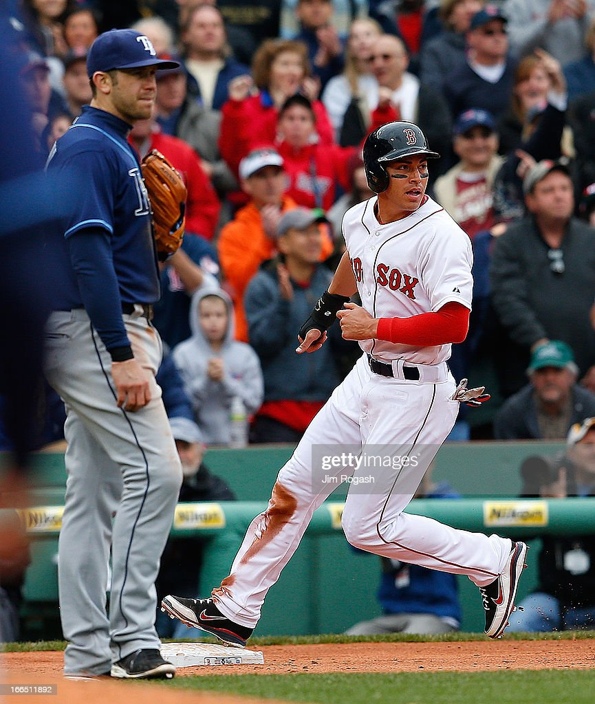<a gi-track='captionPersonalityLinkClicked' href=/galleries/search?phrase=Jacoby+Ellsbury&family=editorial&specificpeople=4172583 ng-click='$event.stopPropagation()'>Jacoby Ellsbury</a> #2 of the Boston Red Sox reaches third after stealing second and making his way to third on an errant throw in the 10th inning as Evan Longoria #3 of the Tampa Bay Rays watches the action at Fenway Park on April 13, 2013 in Boston, Massachusetts. Ellsbury would score the winning run on a single by Shane Victorino #18 of the Boston Red Sox that inning.