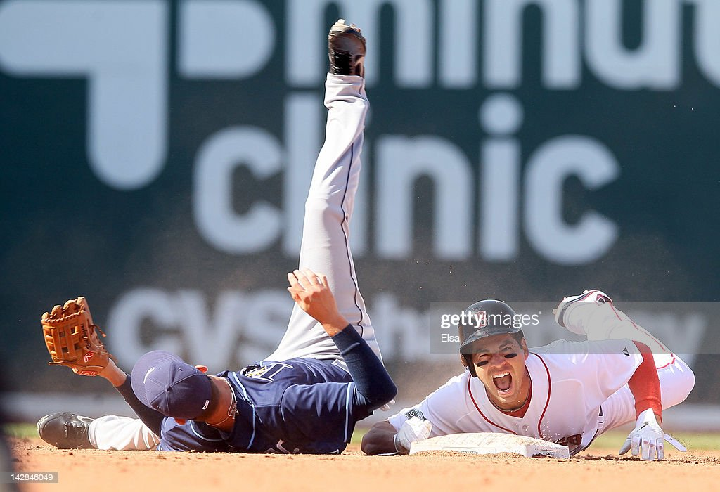 <a gi-track='captionPersonalityLinkClicked' href=/galleries/search?phrase=Jacoby+Ellsbury&family=editorial&specificpeople=4172583 ng-click='$event.stopPropagation()'>Jacoby Ellsbury</a> #2 of the Boston Red Sox reacts after he was injured in a double play in the bottom of the fourth inning by <a gi-track='captionPersonalityLinkClicked' href=/galleries/search?phrase=Reid+Brignac&family=editorial&specificpeople=4175431 ng-click='$event.stopPropagation()'>Reid Brignac</a> #15 of the Tampa Bay Rays the Tampa Bay Rays during the home opener on April 13, 2012 at Fenway Park in Boston, Massachusetts.