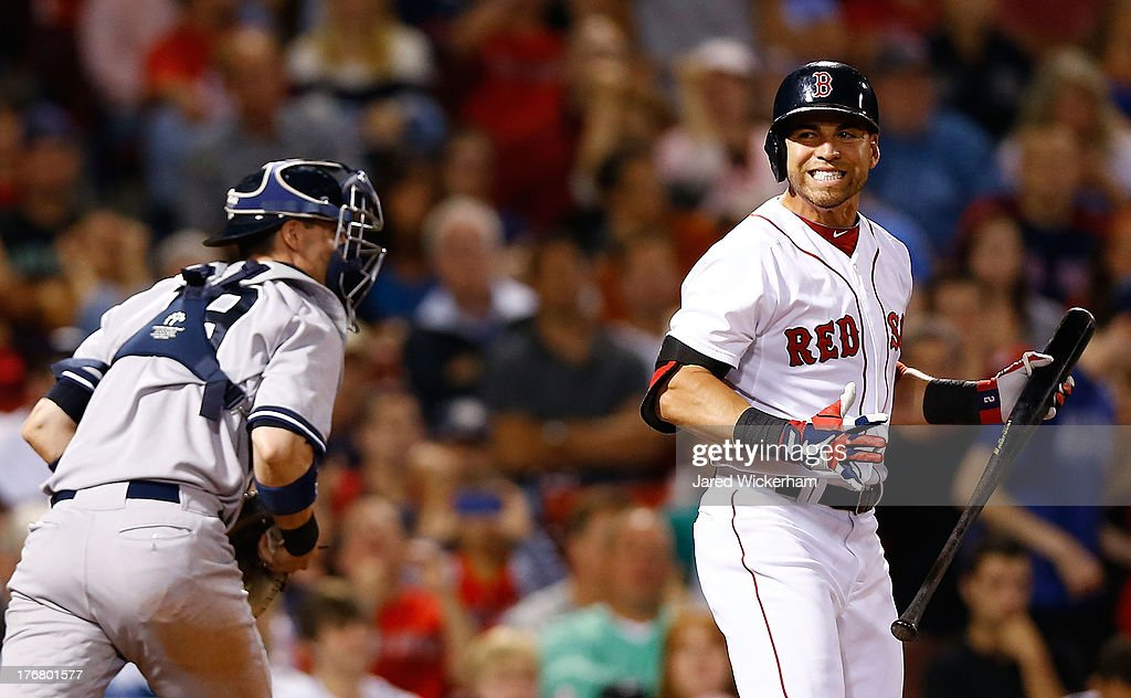 <a gi-track='captionPersonalityLinkClicked' href=/galleries/search?phrase=Jacoby+Ellsbury&family=editorial&specificpeople=4172583 ng-click='$event.stopPropagation()'>Jacoby Ellsbury</a> #2 of the Boston Red Sox reacts after striking out in the 8th inning against the New York Yankees during the game on August 18, 2013 at Fenway Park in Boston, Massachusetts.