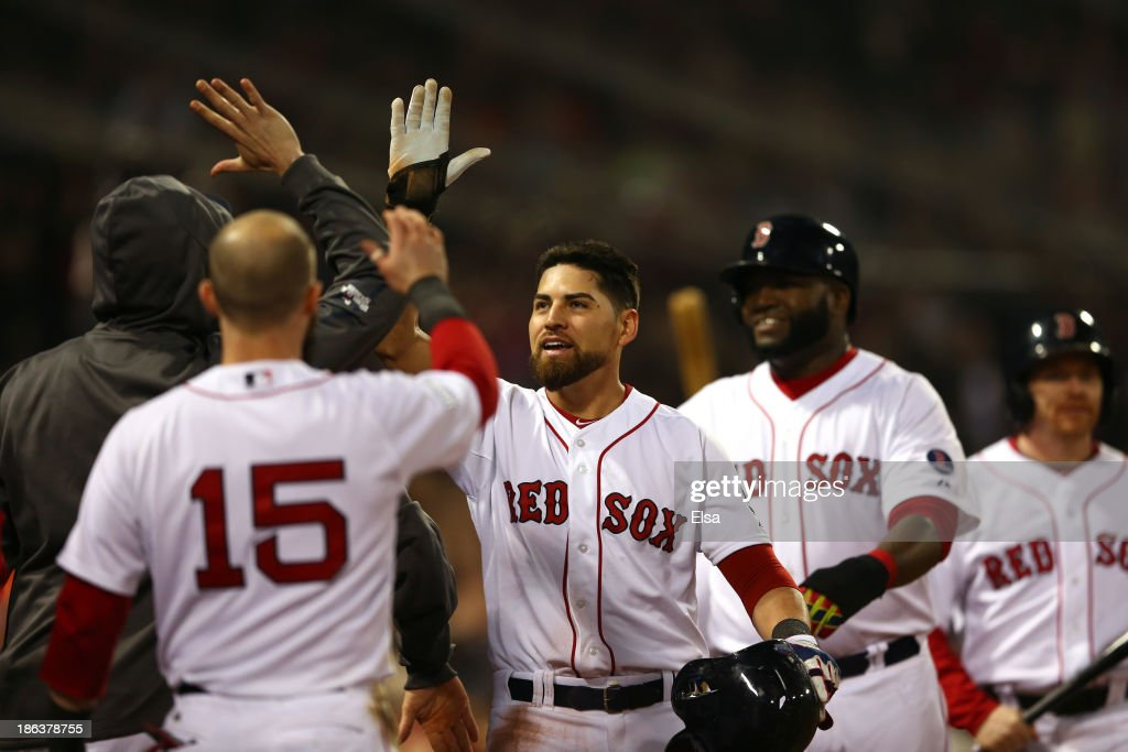 Jacoby Ellsbury of the Boston Red Sox returns to the dugout after scoring in the third inning against the St Louis Cardinals during Game Six of the...