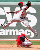 Jacoby Ellsbury of the Boston Red Sox steals second as Erick Aybar of the Los Angeles Angels of Anaheim leaps for a high throw in the 4th inning...