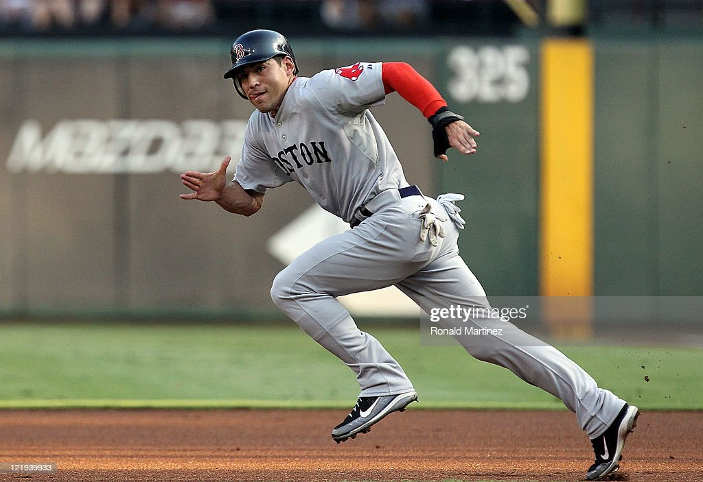 <a gi-track='captionPersonalityLinkClicked' href=/galleries/search?phrase=Jacoby+Ellsbury&family=editorial&specificpeople=4172583 ng-click='$event.stopPropagation()'>Jacoby Ellsbury</a> #2 of the Boston Red Sox steals second base against the Texas Rangers at Rangers Ballpark in Arlington on August 23, 2011 in Arlington, Texas.