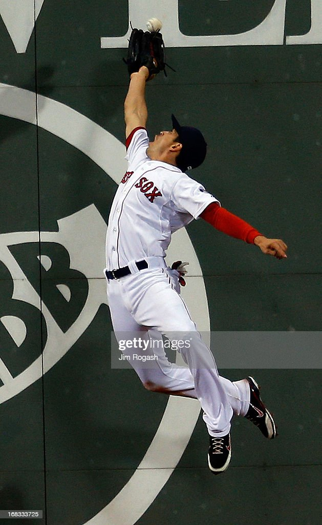 <a gi-track='captionPersonalityLinkClicked' href=/galleries/search?phrase=Jacoby+Ellsbury&family=editorial&specificpeople=4172583 ng-click='$event.stopPropagation()'>Jacoby Ellsbury</a> #2 of the Boston Red Sox traps the ball off the wall hit by Ryan Doumit #9 of the Minnesota Twins in the 7th inning at Fenway Park on May 8, 2013 in Boston, Massachusetts.