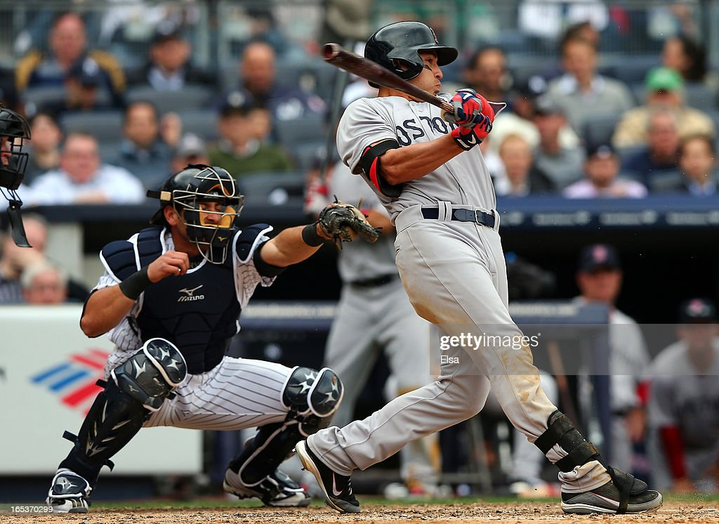 <a gi-track='captionPersonalityLinkClicked' href=/galleries/search?phrase=Jacoby+Ellsbury&family=editorial&specificpeople=4172583 ng-click='$event.stopPropagation()'>Jacoby Ellsbury</a> #2 of the Boston Red Sox watches his hit as <a gi-track='captionPersonalityLinkClicked' href=/galleries/search?phrase=Francisco+Cervelli&family=editorial&specificpeople=4172506 ng-click='$event.stopPropagation()'>Francisco Cervelli</a> #29 of the New York Yankees catches during Opening Day on April 1, 2013 at Yankee Stadium in the Bronx borough of New York City.