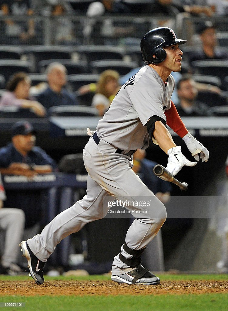 <a gi-track='captionPersonalityLinkClicked' href=/galleries/search?phrase=Jacoby+Ellsbury&family=editorial&specificpeople=4172583 ng-click='$event.stopPropagation()'>Jacoby Ellsbury</a> #2 of the Boston Red Sox watches his three-run home run in the top of the 14th inning against the New York Yankees on September 25, 2011 at Yankee Stadium in the Bronx borough of New York City.