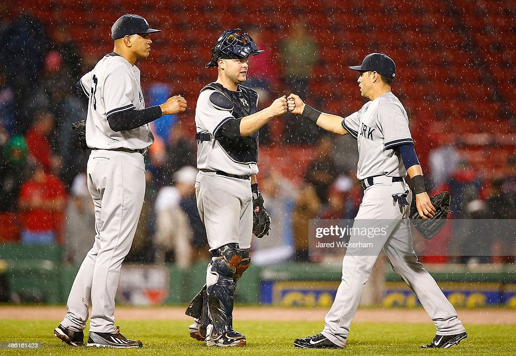 Jacoby Ellsbury #22 of the New York Yankees celebrates their 9-3 win against the Boston Red Sox with teammates Brian McCann #34 and Dellin Betances #68 during the game at Fenway Park on April 22, 2014 in Boston, Massachusetts.