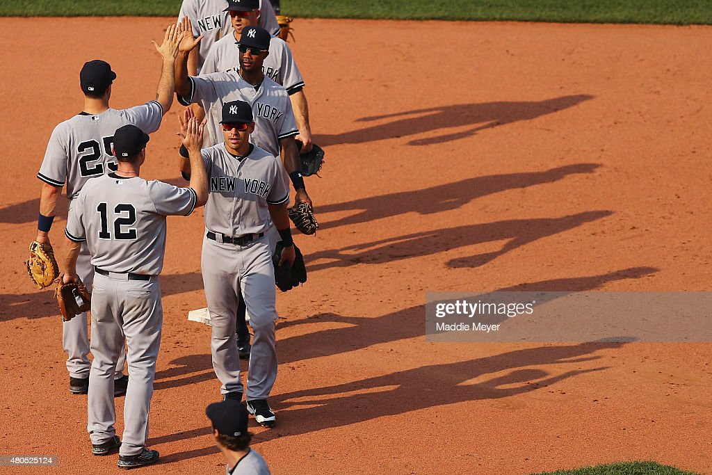 Jacoby Ellsbury of the New York Yankees celebrates with Chase Headley after their game against the Boston Red Sox at Fenway Park on July 12 2015 in...