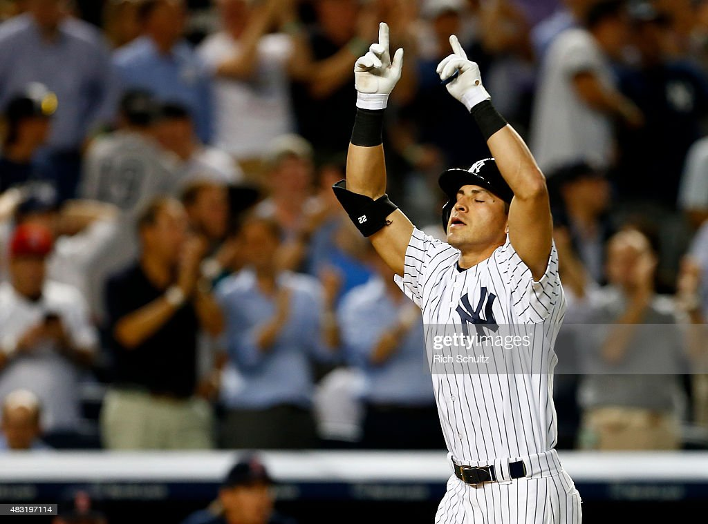 Jacoby Ellsbury of the New York Yankees gestures after hitting a home run in the seventh inning against the Boston Red Sox during a MLB baseball game...