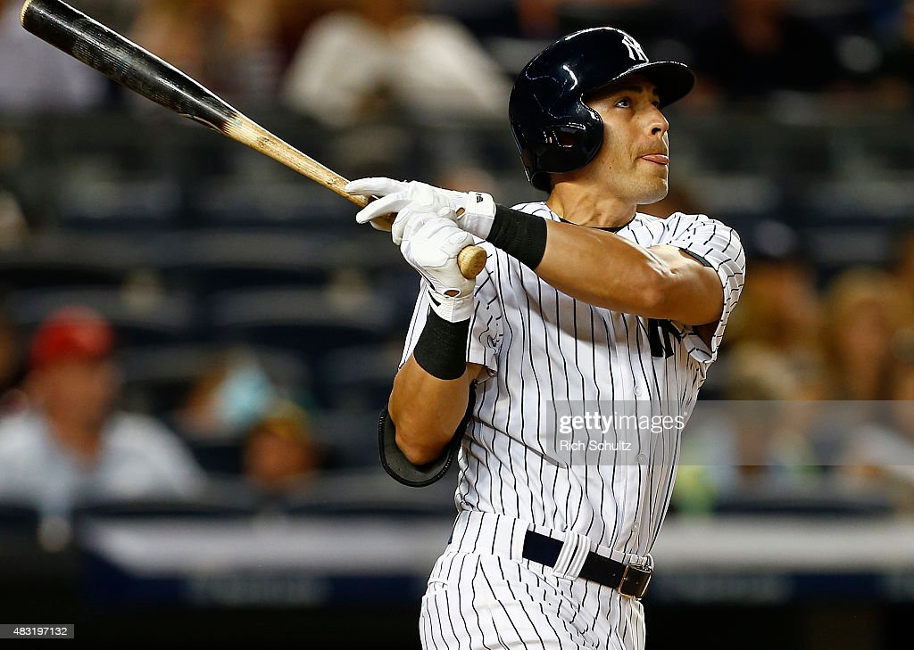 Jacoby Ellsbury #22 of the New York Yankees hits a home run in the seventh inning against the Boston Red Sox during a MLB baseball game at Yankee Stadium on August 6, 2015 in the Bronx borough of New York City.