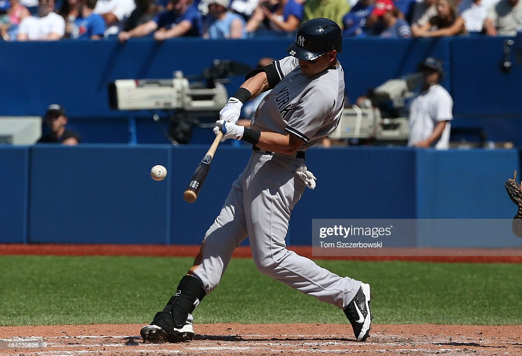 Jacoby Ellsbury #22 of the New York Yankees hits a solo home run in the sixth inning during MLB game action against the Toronto Blue Jays on August 16, 2015 at Rogers Centre in Toronto, Ontario, Canada.