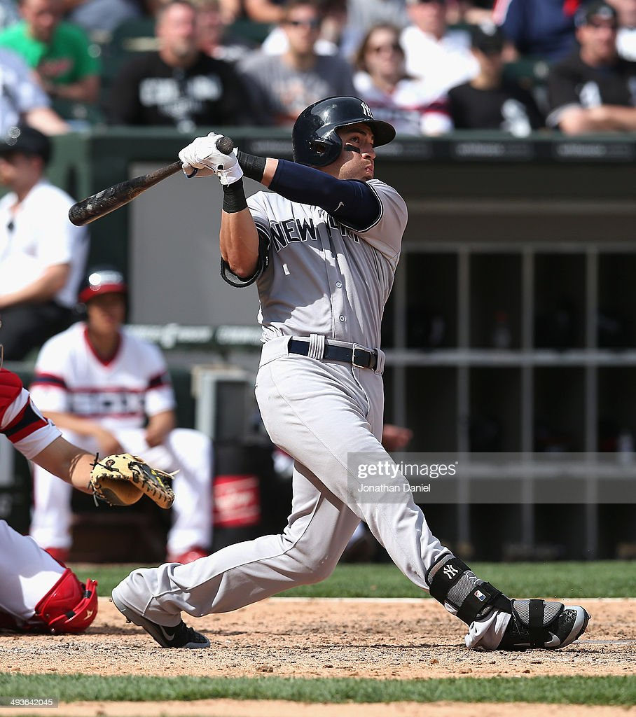 Jacoby Ellsbury of the New York Yankees hits a solo home run in the 10th inning against the Chicago White Sox at US Cellular Field on May 24 2014 in...