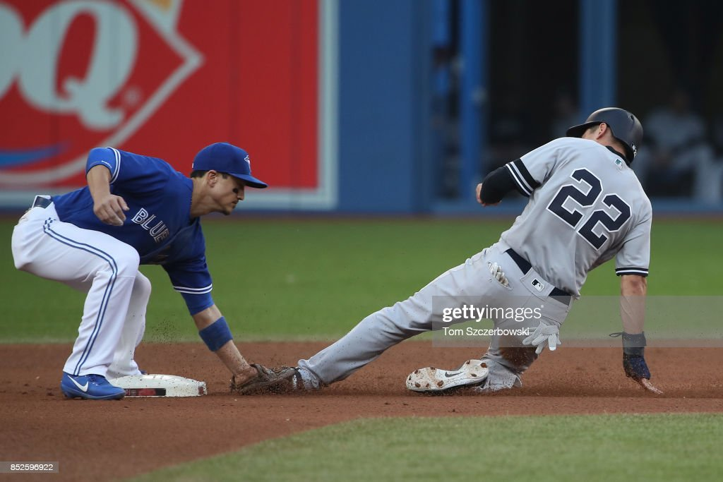 Jacoby Ellsbury #22 of the New York Yankees is caught stealing second base in the seventh inning during MLB game action as Darwin Barney #18 of the Toronto Blue Jays tags him out at Rogers Centre on September 23, 2017 in Toronto, Canada.