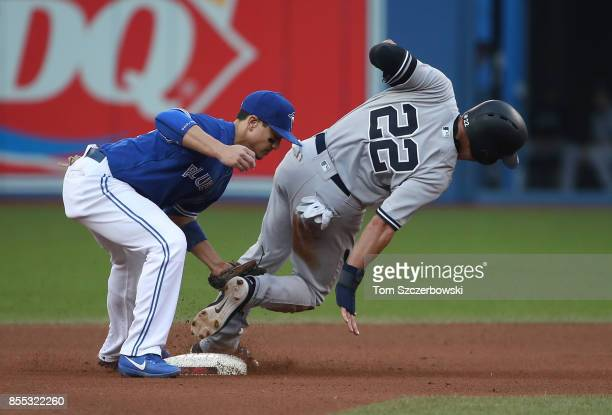 Jacoby Ellsbury of the New York Yankees is caught stealing second base in the seventh inning during MLB game action as Darwin Barney of the Toronto...