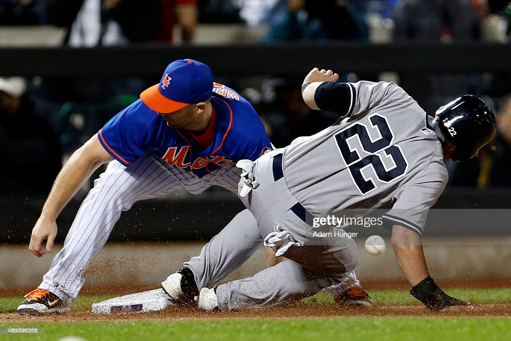 Jacoby Ellsbury of the New York Yankees is safe as David Wright of the New York Mets misplays the ball during the sixth inning at Citi Field on...