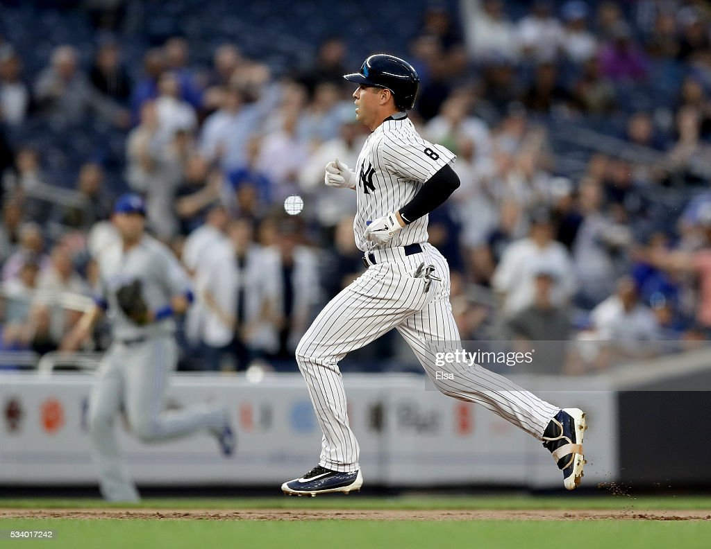 <a gi-track='captionPersonalityLinkClicked' href=/galleries/search?phrase=Jacoby+Ellsbury&family=editorial&specificpeople=4172583 ng-click='$event.stopPropagation()'>Jacoby Ellsbury</a> #22 of the New York Yankees reaches third in the first inning against the Toronto Blue Jays at Yankee Stadium on May 24, 2016 in the Bronx borough of New York City.