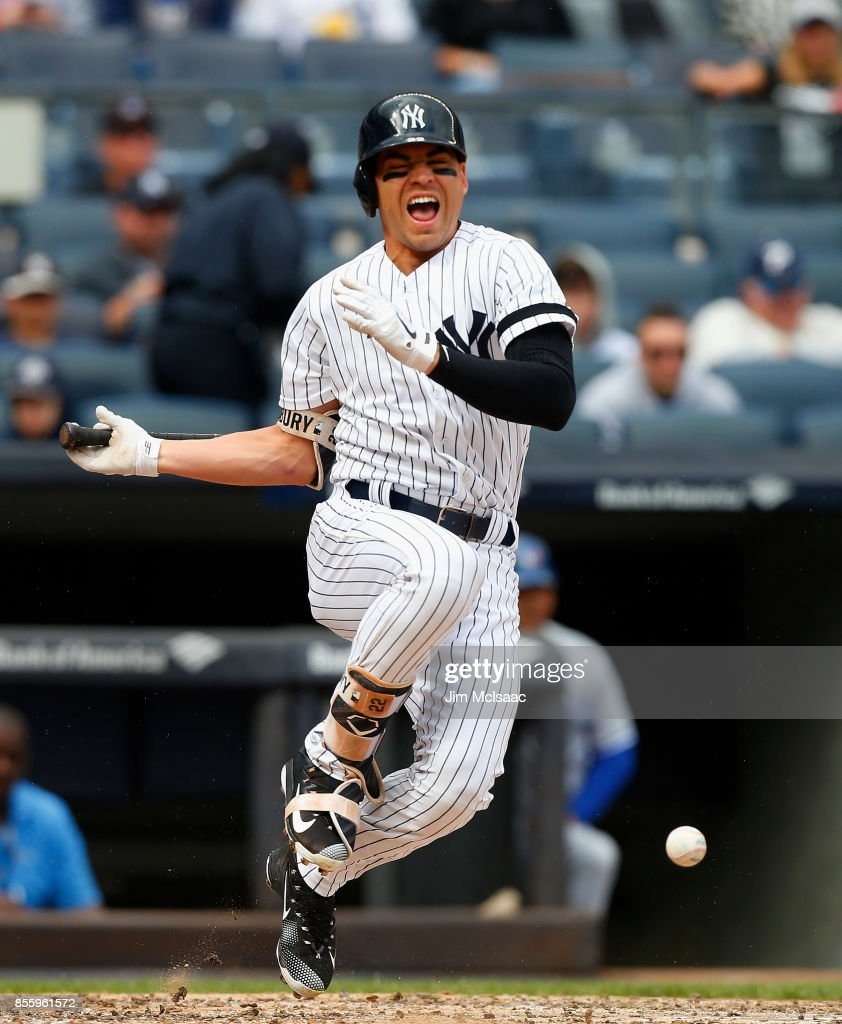Jacoby Ellsbury #22 of the New York Yankees reacts after fouling a ball off of his foot during the third inning against the Toronto Blue Jays at Yankee Stadium on September 30, 2017 in the Bronx borough of New York City.