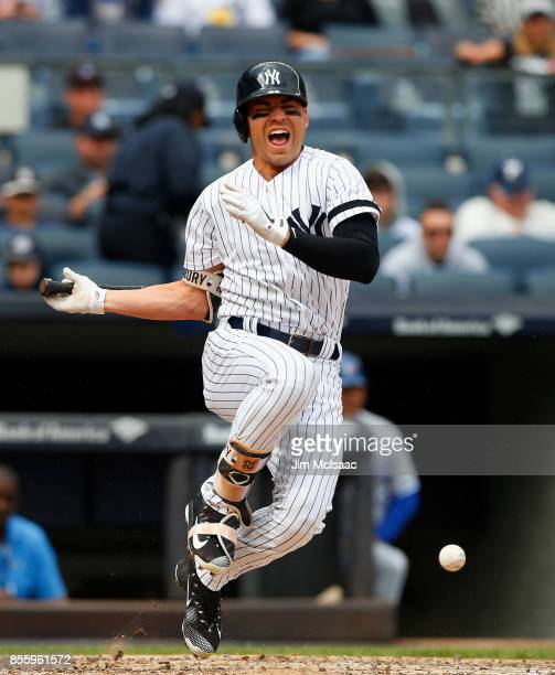Jacoby Ellsbury of the New York Yankees reacts after fouling a ball off of his foot during the third inning against the Toronto Blue Jays at Yankee...