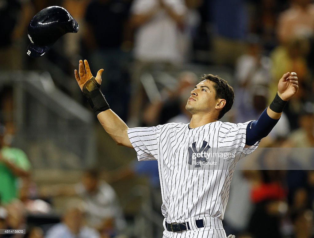 <a gi-track='captionPersonalityLinkClicked' href=/galleries/search?phrase=Jacoby+Ellsbury&family=editorial&specificpeople=4172583 ng-click='$event.stopPropagation()'>Jacoby Ellsbury</a> #22 of the New York Yankees reacts by throwing his helmet in the air after finding out the the run he scored on a stolen base and a two base error were nullified because teammate Mark Teixeira #25 was out looking at a called third strike in the eighth inning against the Boston Red Sox in a MLB baseball game at Yankee Stadium on June 28, 2014 in the Bronx borough of New York City. The Red Sox defeated the Yankees 2-1.