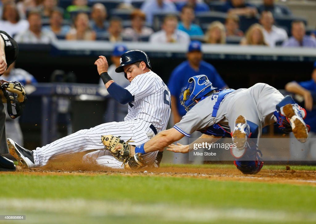 Jacoby Ellsbury of the New York Yankees scores on a sacrifice fly by Carlos Beltran in the third inning against the Toronto Blue Jays at Yankee...