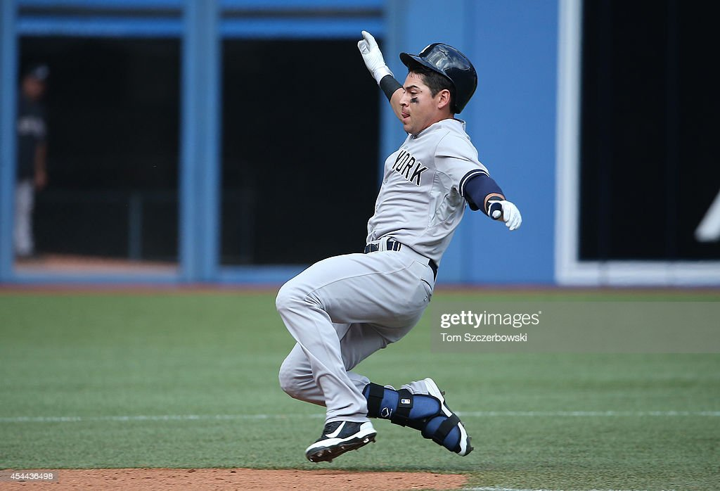 Jacoby Ellsbury #22 of the New York Yankees slides into second base with a double in the ninth inning during MLB game action against the Toronto Blue Jays on August 31, 2014 at Rogers Centre in Toronto, Ontario, Canada.