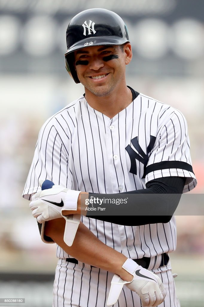 Jacoby Ellsbury #22 of the New York Yankees smiles at the Yankee dugout after coming close to hitting a home run to complete the cycle in the eighth inning against the Minnesota Twins on September 20, 2017 at Yankee Stadium in the Bronx borough of New York City.