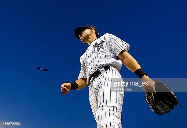 Jacoby Ellsbury of the New York Yankees walks to the dugout during a game against the Tampa Bay Rays at Yankee Stadium on September 4 2015 in the...
