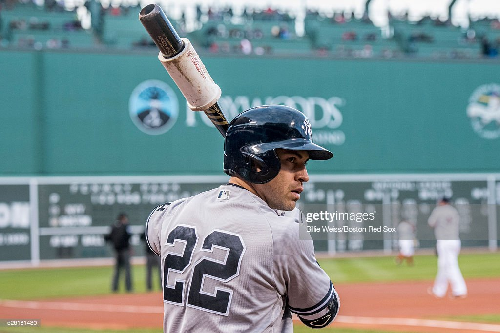 Jacoby Ellsbury #22 of the New York Yankees warms up on deck before a game against the Boston Red Sox on April 29, 2016 at Fenway Park in Boston, Massachusetts .