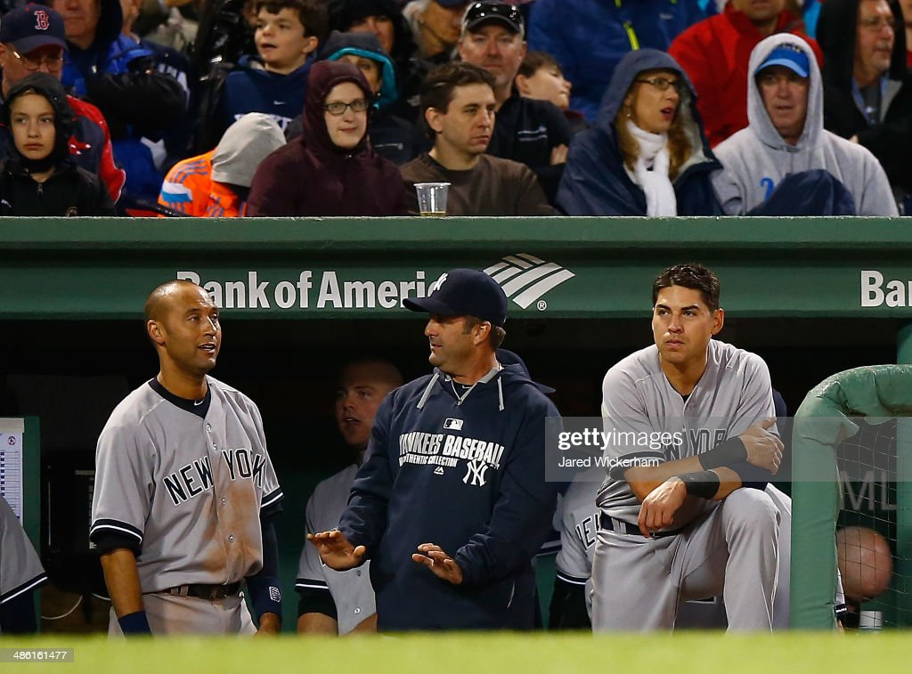 <a gi-track='captionPersonalityLinkClicked' href=/galleries/search?phrase=Jacoby+Ellsbury&family=editorial&specificpeople=4172583 ng-click='$event.stopPropagation()'>Jacoby Ellsbury</a> #22 of the New York Yankees watches the game against the Boston Red Sox from the dugout during the game at Fenway Park on April 22, 2014 in Boston, Massachusetts.