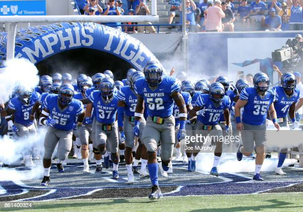 Jacoby Hill of the Memphis Tigers leads his team on the field before a game against the Navy Midshipmen on October 14 2017 at Liberty Bowl Memorial...