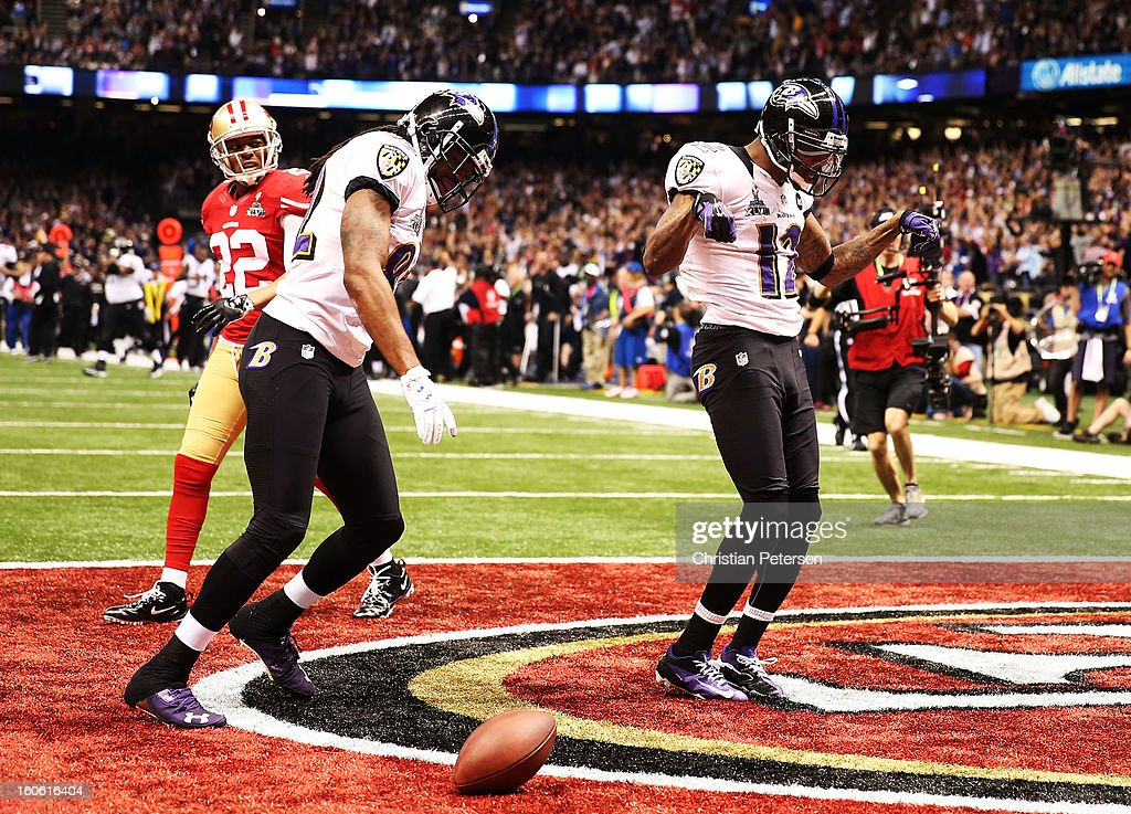 Jacoby Jones and Torrey Smith of the Baltimore Ravens celebrate after Jones scored on a 56yard touchdown reception in the second quarter against...