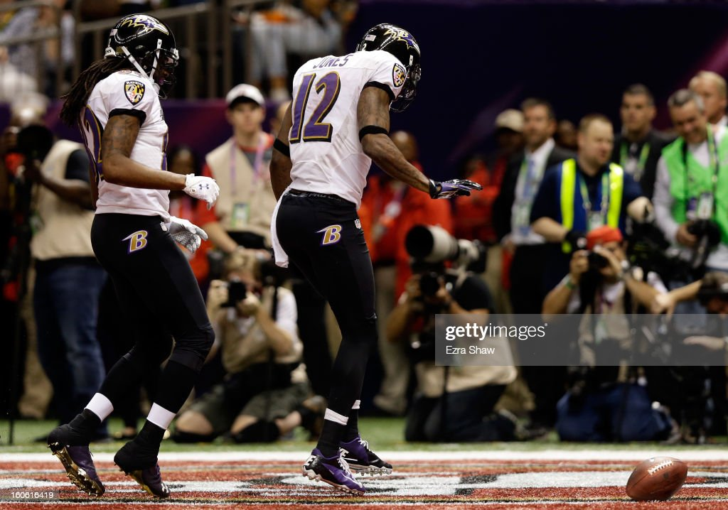 Jacoby Jones celebrates with teammate Torrey Smith of the Baltimore Ravens after scoring a touchdown in the second half against the San Francisco...