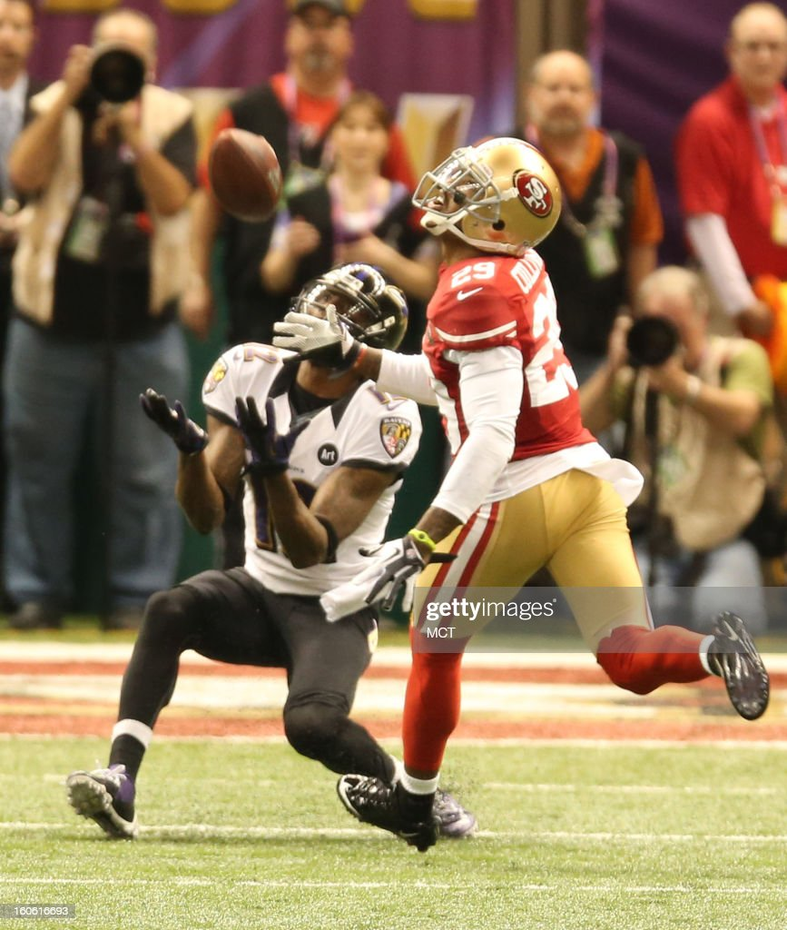 Jacoby Jones (12) of the Baltimore Ravens catches a pass in front of Chris Culliver (29) of the San Francisco 49ers, then ran it in for a touchdown in second-quarter action of Super Bowl XLVII at the Mercedes-Benz Superdome in New Orleans, Louisiana, Sunday, February 3, 2013.
