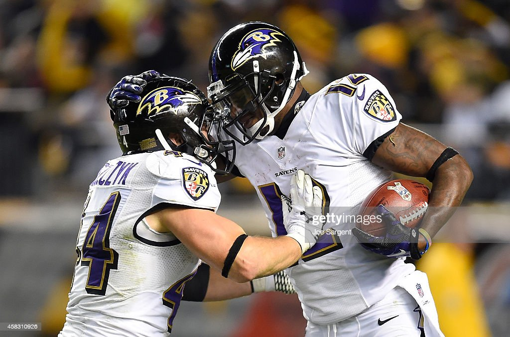 Jacoby Jones #12 of the Baltimore Ravens celebrates his kickoff return for a touchdown with Kyle Juszczyk #44 during the fourth quarter against the Pittsburgh Steelers at Heinz Field on November 2, 2014 in Pittsburgh, Pennsylvania.