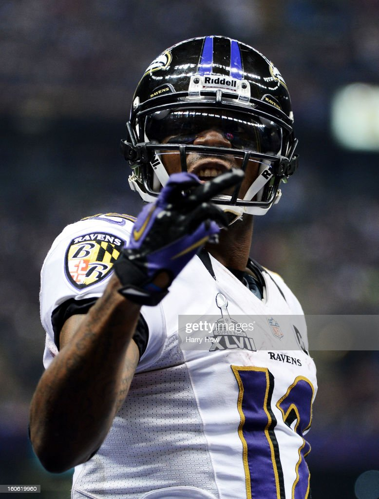 Jacoby Jones #12 of the Baltimore Ravens gestures after he scored a 108-yard kic-off return touchdown to open the third quarter against the San Francisco 49ers during Super Bowl XLVII at the Mercedes-Benz Superdome on February 3, 2013 in New Orleans, Louisiana.
