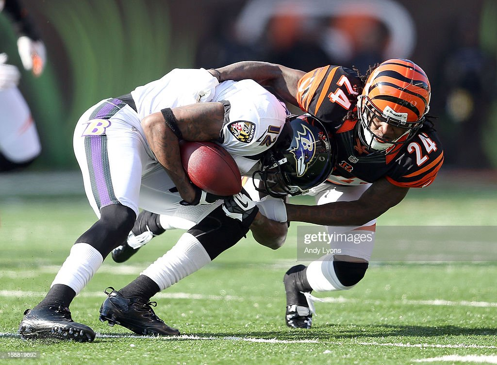 <a gi-track='captionPersonalityLinkClicked' href=/galleries/search?phrase=Jacoby+Jones&family=editorial&specificpeople=4167942 ng-click='$event.stopPropagation()'>Jacoby Jones</a> #12 of the Baltimore Ravens is tackled by Adam Jones #24 of the Cincinnati Bengals during the NFL game at Paul Brown Stadium on December 30, 2012 in Cincinnati, Ohio.