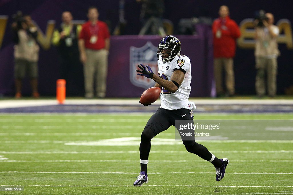 Jacoby Jones #12 of the Baltimore Ravens returns a kick-off 108 yards for a touchdown to open in the second half against the San Francisco 49ers during Super Bowl XLVII at the Mercedes-Benz Superdome on February 3, 2013 in New Orleans, Louisiana.