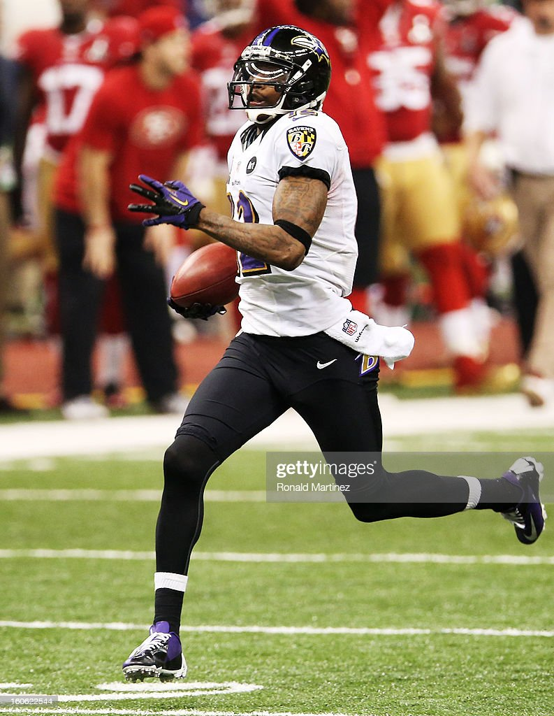 Jacoby Jones #12 of the Baltimore Ravens returns a kick-off 109 yards for a touchdown to open in the second half against the San Francisco 49ers during Super Bowl XLVII at the Mercedes-Benz Superdome on February 3, 2013 in New Orleans, Louisiana.