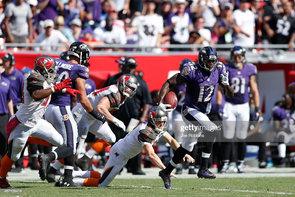 <a gi-track='captionPersonalityLinkClicked' href=/galleries/search?phrase=Jacoby+Jones&family=editorial&specificpeople=4167942 ng-click='$event.stopPropagation()'>Jacoby Jones</a> #12 of the Baltimore Ravens returns a kickoff 58 yards in the third quarter of the game against the Tampa Bay Buccaneers at Raymond James Stadium on October 12, 2014 in Tampa, Florida. The Ravens defeated the Buccaneers 48-17.